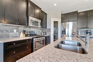 Photo 6: 145 Rainbow Falls Heath: Chestermere Detached for sale : MLS®# A1120150