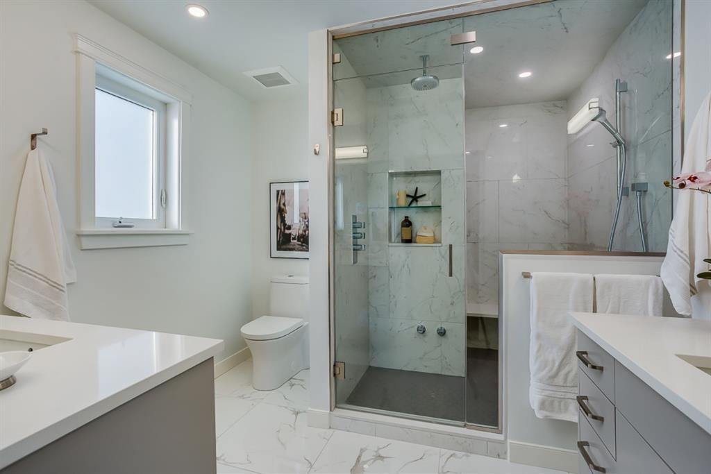 Photo 21: Photos: 219 Somme Manor SW in Calgary: Garrison Woods Detached for sale : MLS®# A1041747