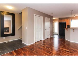 Photo 3: 136 EVERSYDE Boulevard SW in Calgary: Evergreen House for sale : MLS®# C4081553
