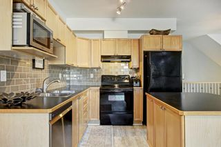 Photo 4: 401 8000 Wentworth Drive SW in Calgary: West Springs Row/Townhouse for sale : MLS®# A1148308