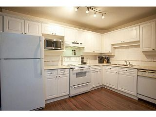 """Photo 5: 201 5556 201A Street in Langley: Langley City Condo for sale in """"Michaud Gardens"""" : MLS®# F1421361"""