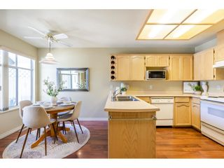 """Photo 11: 106 19649 53 Avenue in Langley: Langley City Townhouse for sale in """"Huntsfield Green"""" : MLS®# R2595915"""