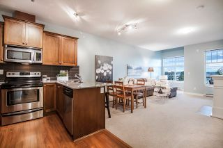 """Main Photo: 406 17712 57A Avenue in Surrey: Cloverdale BC Condo for sale in """"WEST on the Village Walk"""" (Cloverdale)  : MLS®# R2441969"""