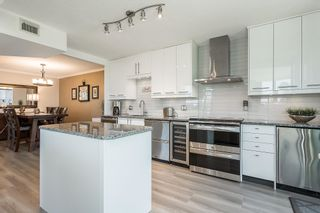 """Photo 6: 404 32330 SOUTH FRASER Way in Abbotsford: Central Abbotsford Condo for sale in """"Town Centre Tower"""" : MLS®# R2605342"""