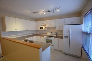 Main Photo: 6 Sandpiper Court NW in Calgary: Sandstone Valley Row/Townhouse for sale : MLS®# A1116711