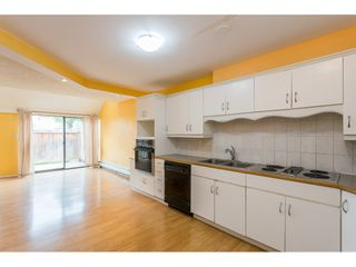 """Photo 1: 102 17718 60 Avenue in Surrey: Cloverdale BC Townhouse for sale in """"CLOVER PARK GARDENS"""" (Cloverdale)  : MLS®# R2498057"""