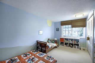 Photo 19: 373 Point Mckay Gardens NW in Calgary: Point McKay Row/Townhouse for sale : MLS®# A1063969