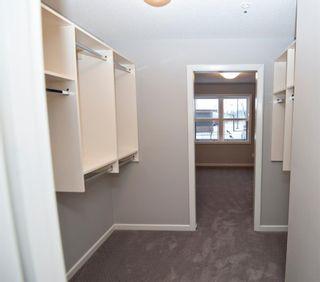 Photo 10: 2102 10 Market Boulevard SE: Airdrie Apartment for sale : MLS®# A1054506