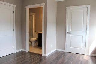 Photo 32: 1404 Clover Link: Carstairs Row/Townhouse for sale : MLS®# A1073804