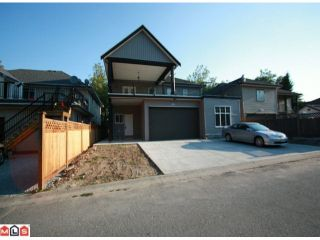 Photo 10: 12933 88TH Avenue in Surrey: Queen Mary Park Surrey House for sale : MLS®# F1021819