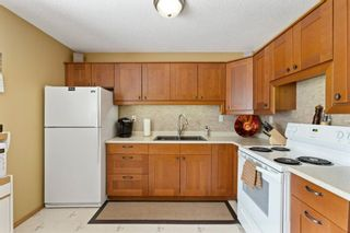 Photo 4: 15 1845 Lysander Crescent SE in Calgary: Ogden Row/Townhouse for sale : MLS®# A1093994