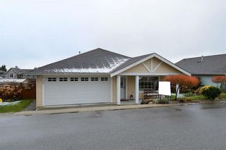 """Photo 1: 5704 EMILY Way in Sechelt: Sechelt District House for sale in """"CASCADE"""" (Sunshine Coast)  : MLS®# R2144070"""