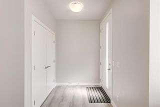 Photo 11: 125 Redstone Crescent NE in Calgary: Redstone Row/Townhouse for sale : MLS®# A1124721