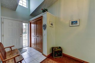Photo 3: 14 6841 Coach Hill Road SW in Calgary: Coach Hill Residential for sale : MLS®# A1059348