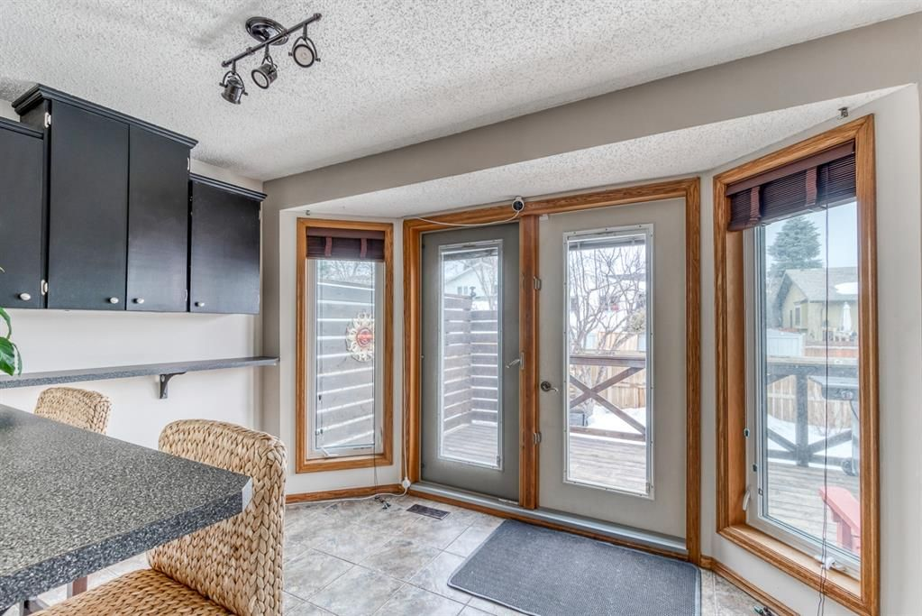 Photo 13: Photos: 47 Douglas Woods Way SE in Calgary: Douglasdale/Glen Detached for sale : MLS®# A1076729