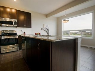 Photo 6: 24 SAGE HILL Point NW in CALGARY: Sage Hill Residential Attached for sale (Calgary)  : MLS®# C3479090