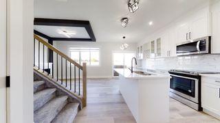 Photo 2: 19708 28 Avenue in Edmonton: Zone 57 House for sale : MLS®# E4266373