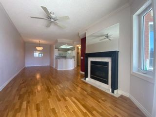 Photo 2: 107 200 Patina Court SW in Calgary: Patterson Apartment for sale : MLS®# A1093695