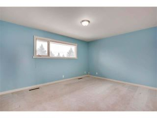 Photo 12: 3039 CANMORE Road NW in Calgary: Banff Trail House for sale