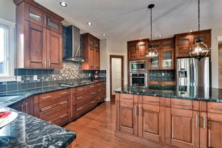 Photo 13: 80 Rockcliff Point NW in Calgary: Rocky Ridge Detached for sale : MLS®# A1150895