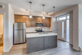 Photo 2: 12 30 Shawnee Common SW in Calgary: Shawnee Slopes Apartment for sale : MLS®# A1106401