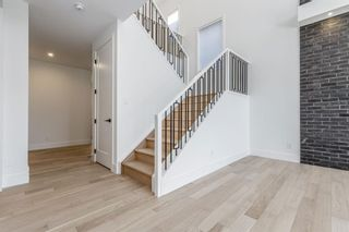 Photo 18: 7853 8A Avenue SW in Calgary: West Springs Detached for sale : MLS®# A1136445
