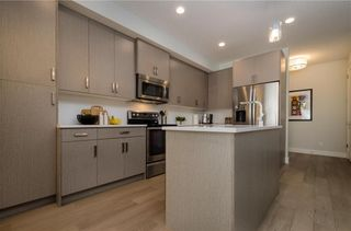 Photo 6: 2 1920 25A Street SW in Calgary: Richmond Row/Townhouse for sale : MLS®# A1127031