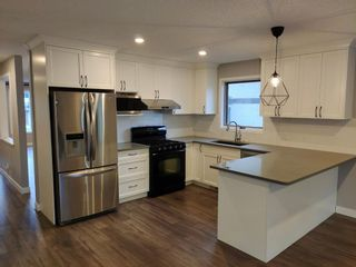 Photo 2: 72 EDENDALE Way NW in Calgary: Edgemont Detached for sale : MLS®# A1080431