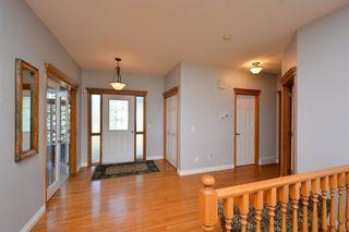 Photo 3: 303 GLENEAGLES View: Cochrane House for sale : MLS®# C4130061