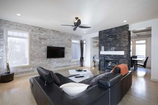 Photo 3: 131 SPRINGBLUFF Boulevard SW in Calgary: Springbank Hill Detached for sale : MLS®# A1066910