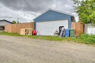 Photo 45: 212 Queen Alexandra Road SE in Calgary: Queensland Detached for sale : MLS®# A1118884