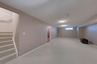 Photo 23: 38 1008 Woodside Way NW: Airdrie Row/Townhouse for sale : MLS®# A1123458