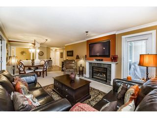 "Photo 1: 308 13860 70 Avenue in Surrey: East Newton Condo for sale in ""Chelsea Garden"" : MLS®# R2249748"