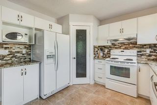 Photo 5: 915 ARBOUR LAKE Road NW in Calgary: Arbour Lake Detached for sale : MLS®# A1031493
