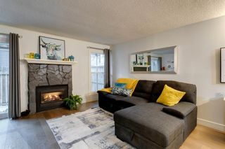 Photo 3: 161 76 Glamis Green SW in Calgary: Glamorgan Row/Townhouse for sale : MLS®# A1053014