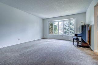 Photo 6: 319 Parkland Way SE in Calgary: Parkland Detached for sale : MLS®# A1102560