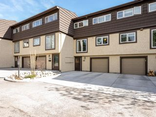 Photo 1: 616 3130 66 Avenue SW in Calgary: Lakeview Row/Townhouse for sale : MLS®# A1106469
