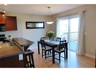 Photo 17: 772 LUXSTONE Landing SW: Airdrie House for sale : MLS®# C4016201