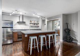 Photo 3: 701 300 MEREDITH Road NE in Calgary: Crescent Heights Apartment for sale : MLS®# A1083001
