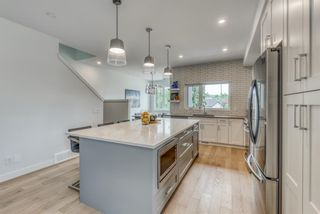 Photo 11: 98 23 Street NW in Calgary: West Hillhurst Row/Townhouse for sale : MLS®# A1066637