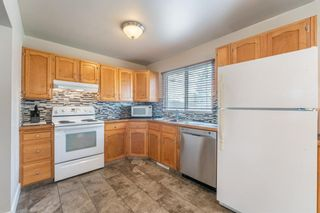 Photo 5: 99 Flavelle Road SE in Calgary: Fairview Detached for sale : MLS®# A1151118