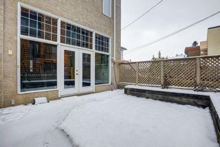 Photo 9: 1717 College Lane SW in Calgary: Lower Mount Royal Row/Townhouse for sale : MLS®# A1132774