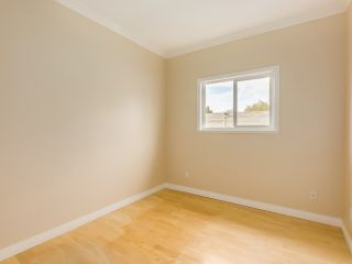 Photo 14: 1125 East 61st Avenue in Vancouver: South Vancouver Home for sale ()  : MLS®# R2002143