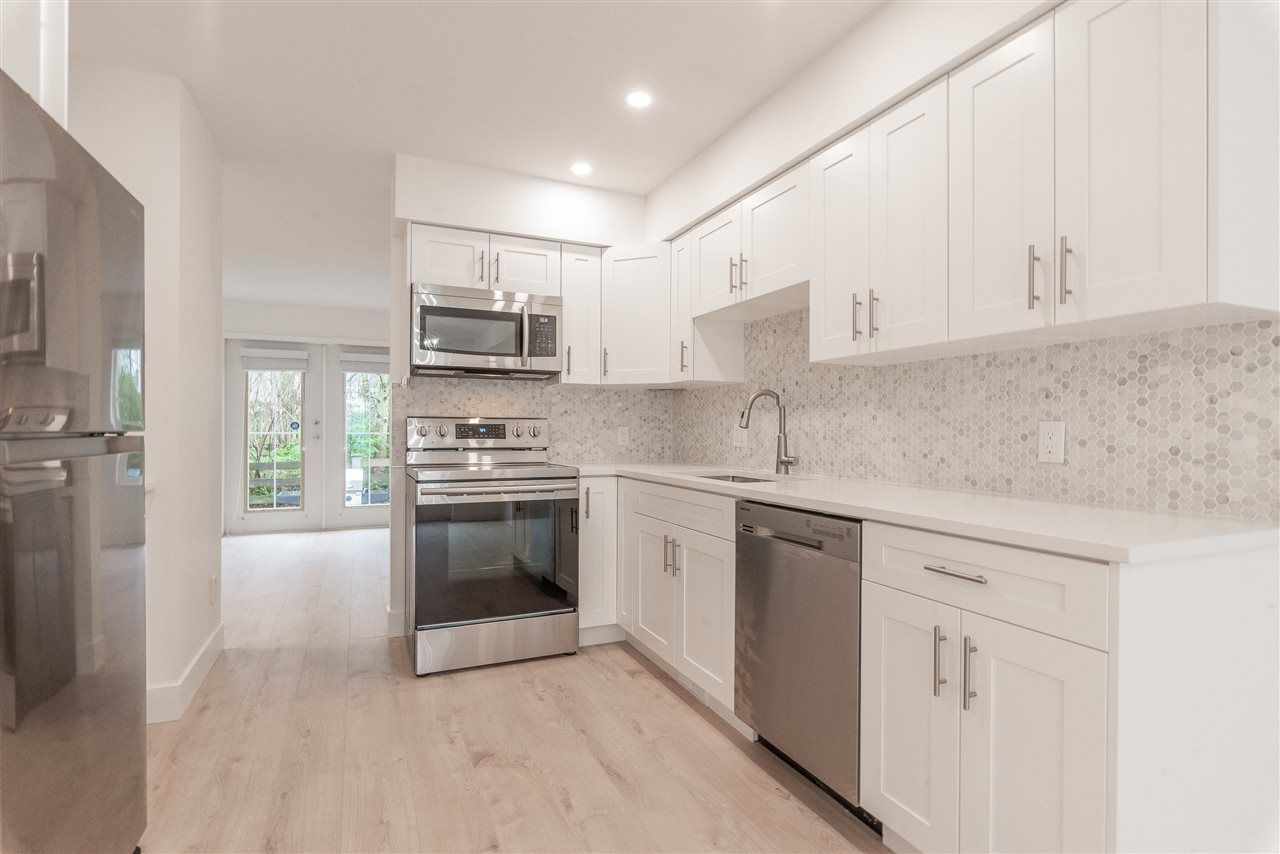 """Main Photo: 15 15488 101A Avenue in Surrey: Guildford Townhouse for sale in """"Cobblefield Lane"""" (North Surrey)  : MLS®# R2449529"""