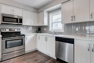 Photo 13: 205 1225 Kings Heights Way SE: Airdrie Row/Townhouse for sale : MLS®# A1122375