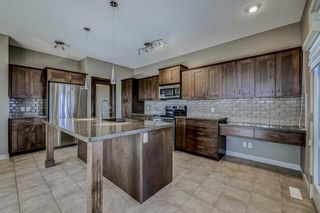 Photo 5: 26 BRIGHTONWOODS Bay SE in Calgary: New Brighton Detached for sale : MLS®# A1110362