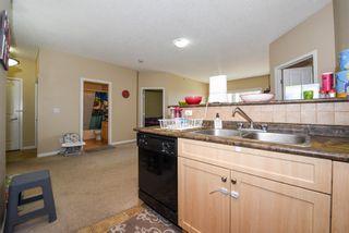 Photo 4: 2412 1140 TARADALE Drive NE in Calgary: Taradale Apartment for sale : MLS®# A1149242