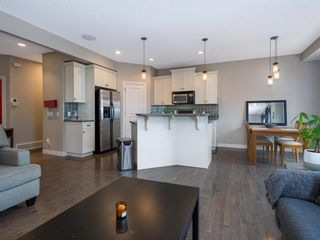 Photo 5: 27 Cougar Plateau Way SW in Calgary: Cougar Ridge Detached for sale : MLS®# A1113604