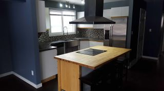 """Photo 1: 7147 GUELPH Crescent in Prince George: Lower College 1/2 Duplex for sale in """"COLLEGE HEIGHTS"""" (PG City South (Zone 74))  : MLS®# R2574398"""