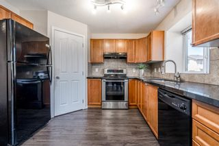 Photo 4: 122 Luxstone Road SW: Airdrie Detached for sale : MLS®# A1129612